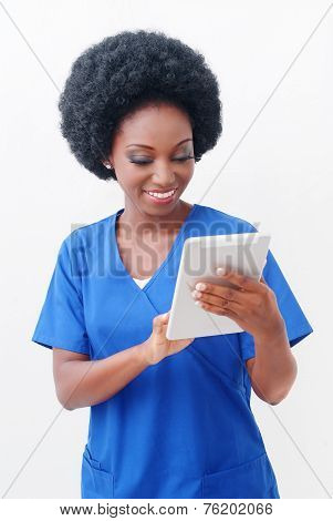 Female Nurse Working On Digital Tablet PC