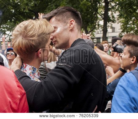 Unidentified Gay Couple Cuddling During Gay Pride Parade