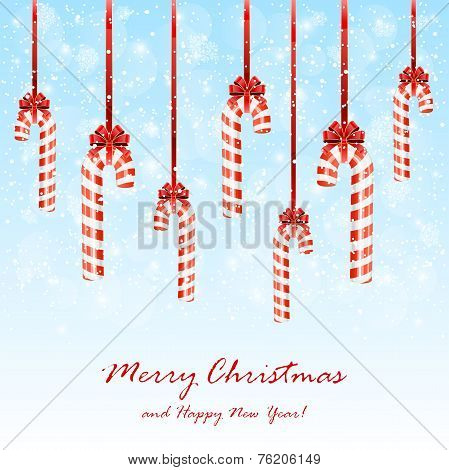 Christmas Candies With Bow On Snowy Background