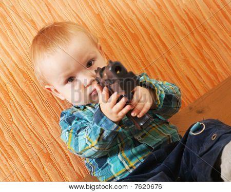 Boy Plays With Gun