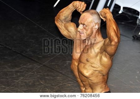 Male Bodybuilding Contestant Showing His Double Biceps