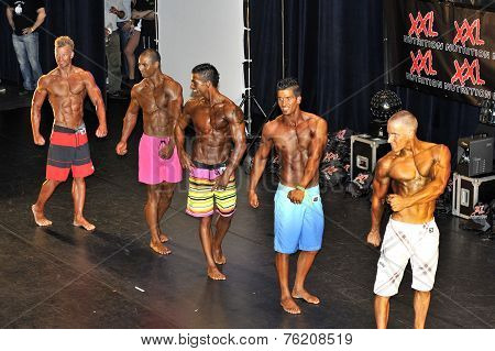 Male Fitness Contestant Showing His Best
