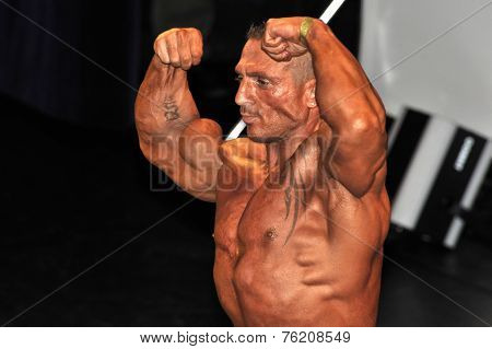 Male Bodybuilding Contestant Showing His Double Biceps Pose
