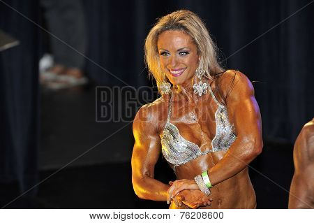 Female Bodybuilding Contestant Showing Her Chest Pose