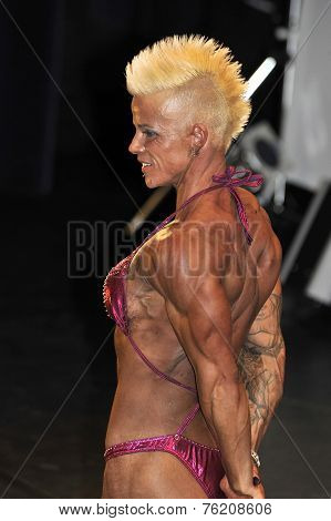 Female Bodybuilding Contestant Showing Her Best