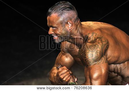 Male Bodybuilding Contestant Showing His Best