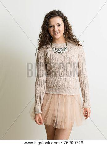 Curly Brunette In Pink Mini Skirt
