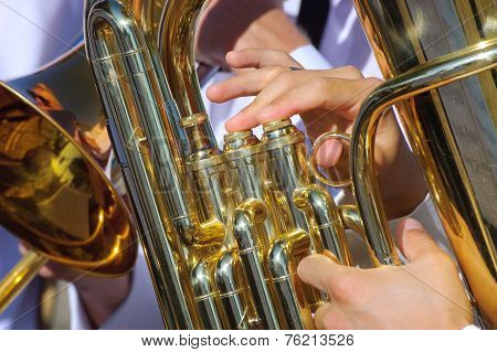 Musician playing tuba in street orchestra