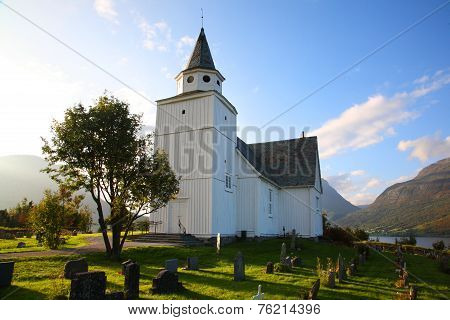 Scenic view of Vang church, Oppland, Norway, on a clear, bright sky.
