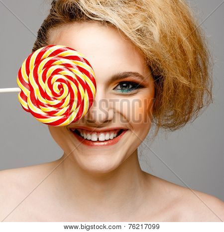 Woman Licks Candy With Beautiful Make-up Isolated On White Background