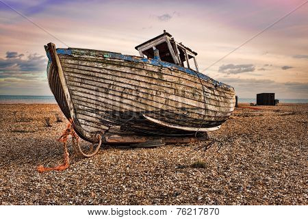 Beautiful view of the sea rocky beach with old wooden fishing boat,H D R
