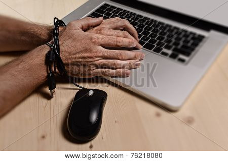 Hands Of Businessman Addicted To Work Bond With Mouse Cable To Computer Laptop In Workaholic