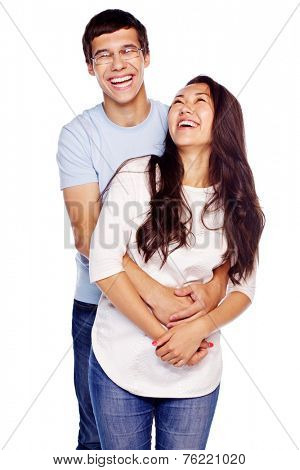 Portrait of young embracing couple isolated on white background