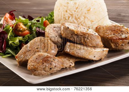 Fried pork loin,white rice and vegetable salad