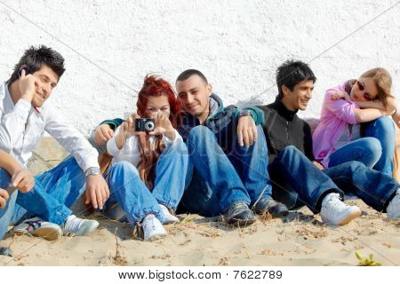 Group Of Teenagers On The Beach