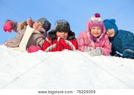Children in winter. Happy kids on snow
