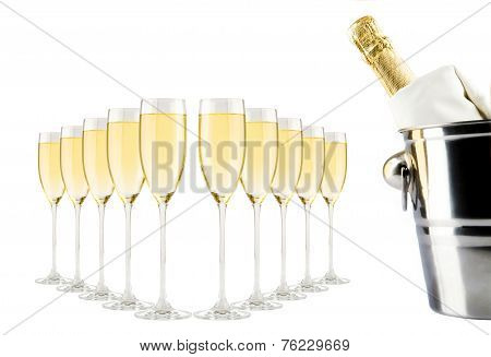 Champagne bottle in bucket with ice and glasses of champagne