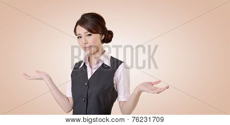 Helpless young business woman shrugs her shoulders. closeup portrait