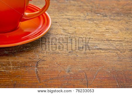 stoneware coffee cup on grunge rustic wooden table with a copy space