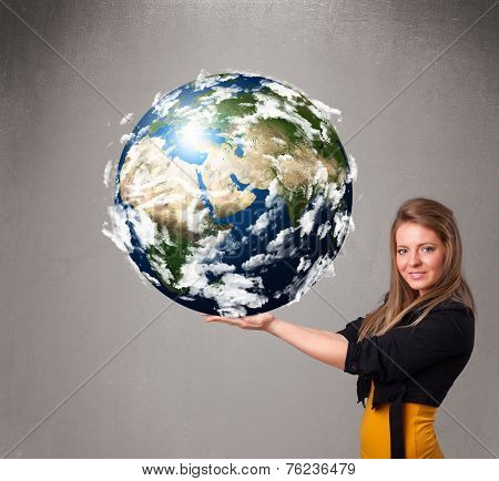 Pretty young girl holding 3d planet earth