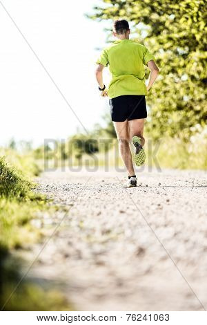 Man Jogging In Summer On Country Road
