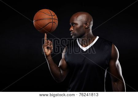Young African Athlete Balancing Basketball On His Finger