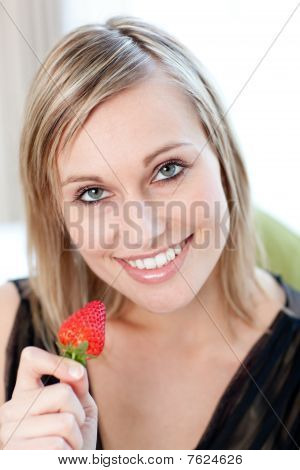 Charming Woman Eating A Strawberry