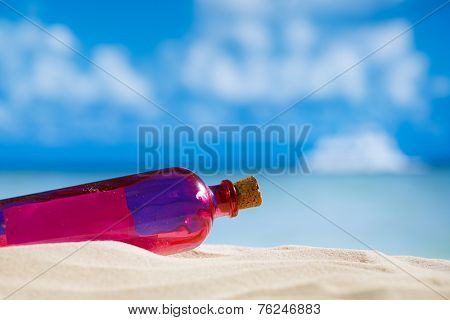 Message in a bottle on  beach with seascape background