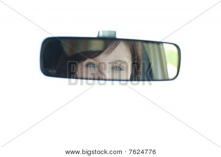 Young Woman Looking In The Rear-view Mirror