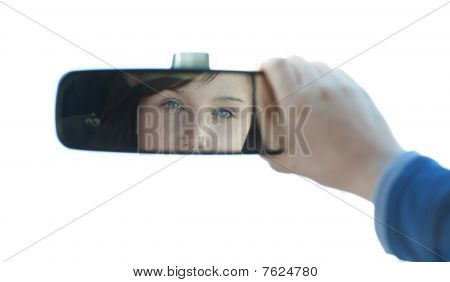 Brunette Woman Looking In The Rear-view Mirror