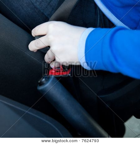 Close-up Of Woman Putting Seat Belt