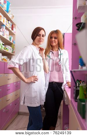 Two Nurses At The Pharmacy Desk