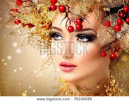 Christmas Winter Fashion Model Girl with golden hairstyle and make up. Beauty Woman. Beautiful New Year Holiday Creative Hair style decorated with holly berries. Beauty Lady face
