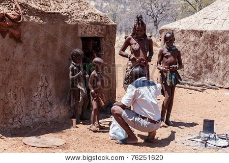 Himba Woman With Children In The Village