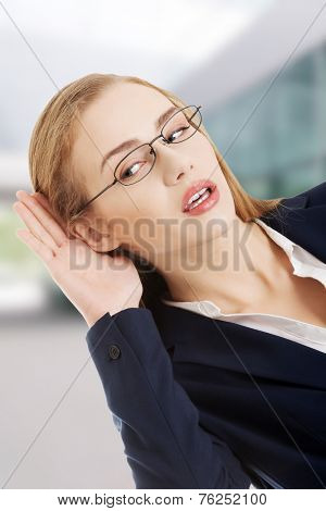 Beautiful caucasian business woman is overhearing