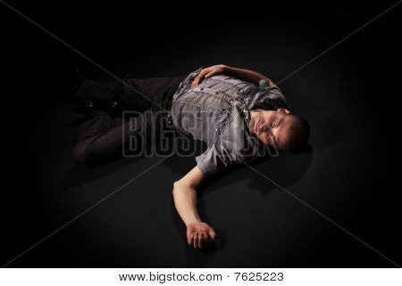 Dead Body Lying On Floor