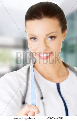 Attractive young female doctor with scalpel