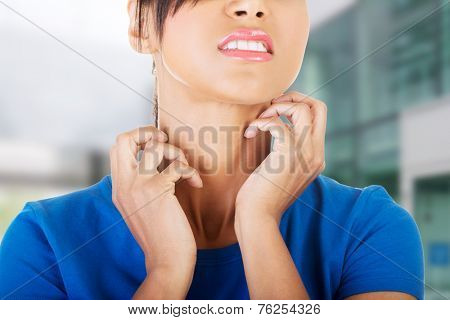 Young beautiful woman scratching her self