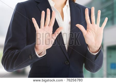 Beautiful caucasian business woman showing stop gesture