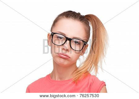 Disappointed teen girl in glasses