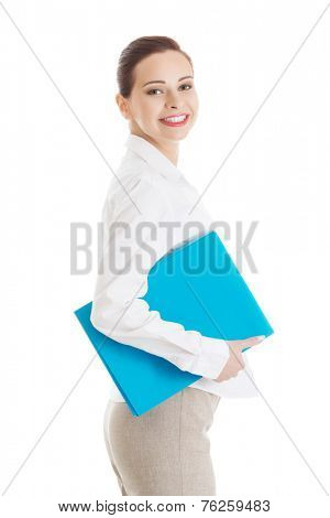 Side view businesswoman holding binder.