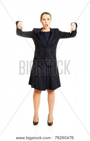Pretty young businesswoman pointing down