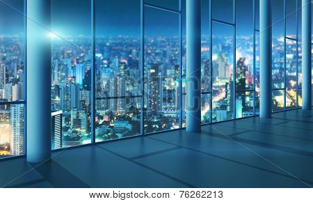 Office with glass wall and evening city