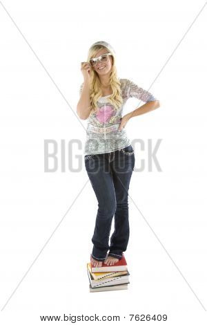 Girl In Glasses Standing On Books