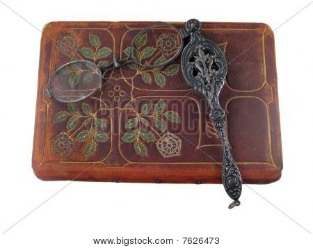 Isolated Old Leather Book And Lorgnette