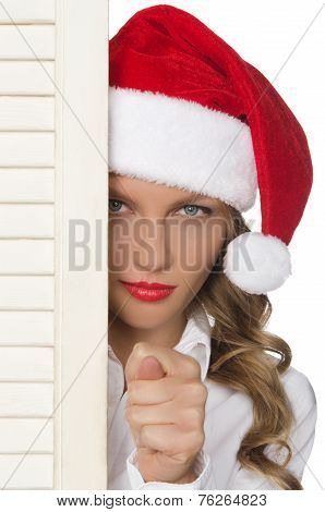 Offended Woman In Santa Hat Showing  Bad Gesture