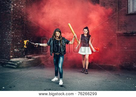 Two Bad Girls With Molotov Cocktail And Red Smoke Bomb