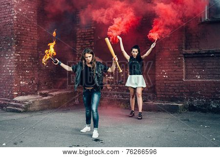 Two Aggressive Women With Molotov Cocktail Bomb In The Street