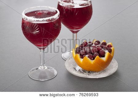 Cold Drink With Cranberries, Orange Juice And Ice  .