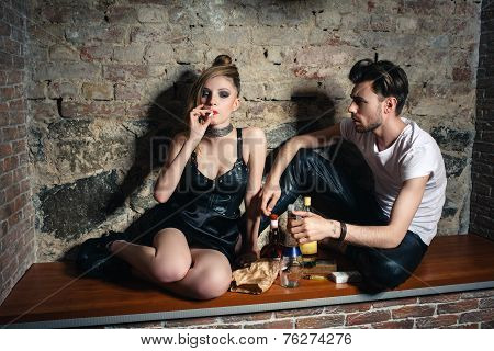 The couple with ciggarettes and alcohol